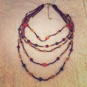 Jewelry - Five string beaded necklace.